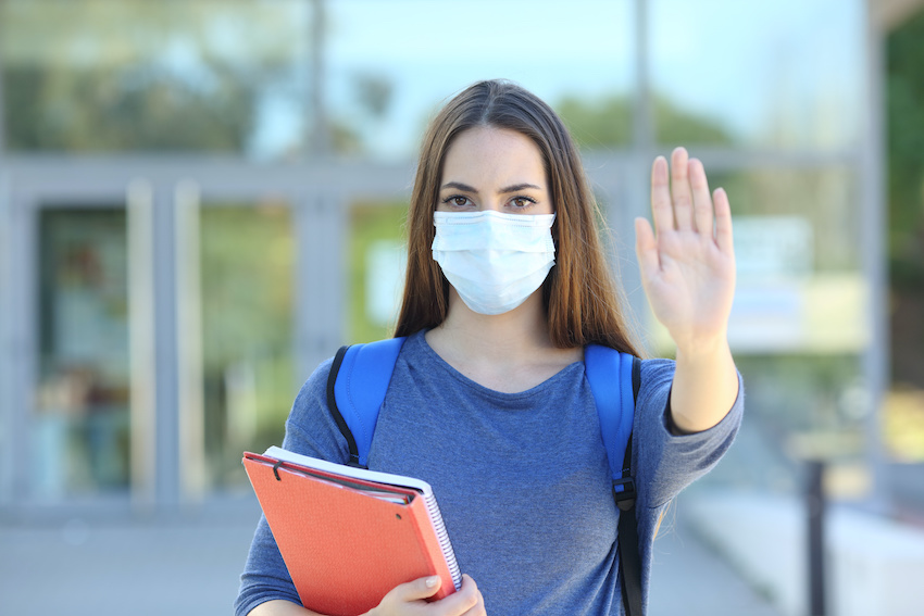 A student wearing a medical face mask to protect against coronavirus