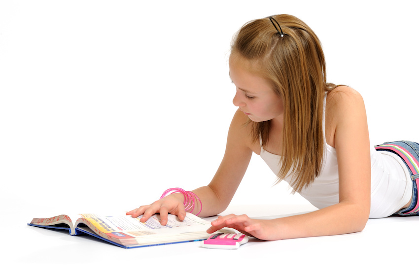 adding and subtracting decimals: girl reading a book on her belly