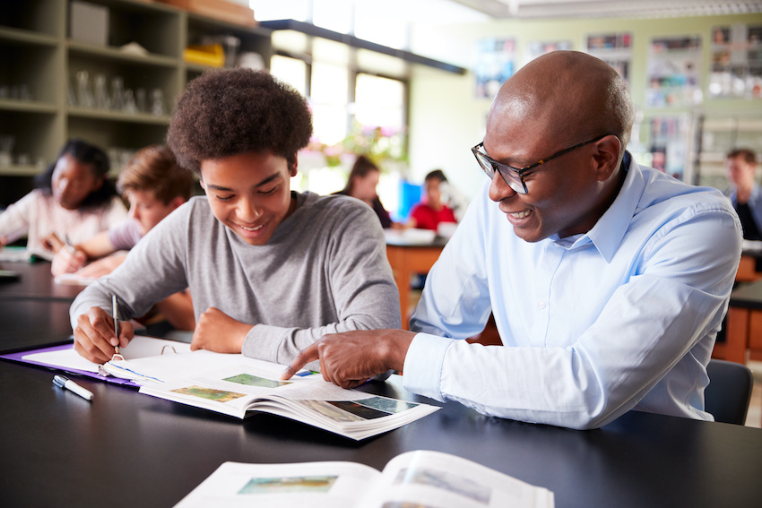 Perfect SAT score: A student works one-on-one with a tutor