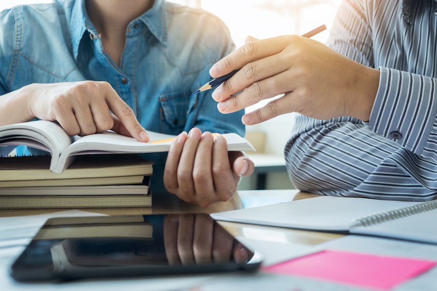 In-person vs. online tutor: A tutor helps a student understand a passage in a book