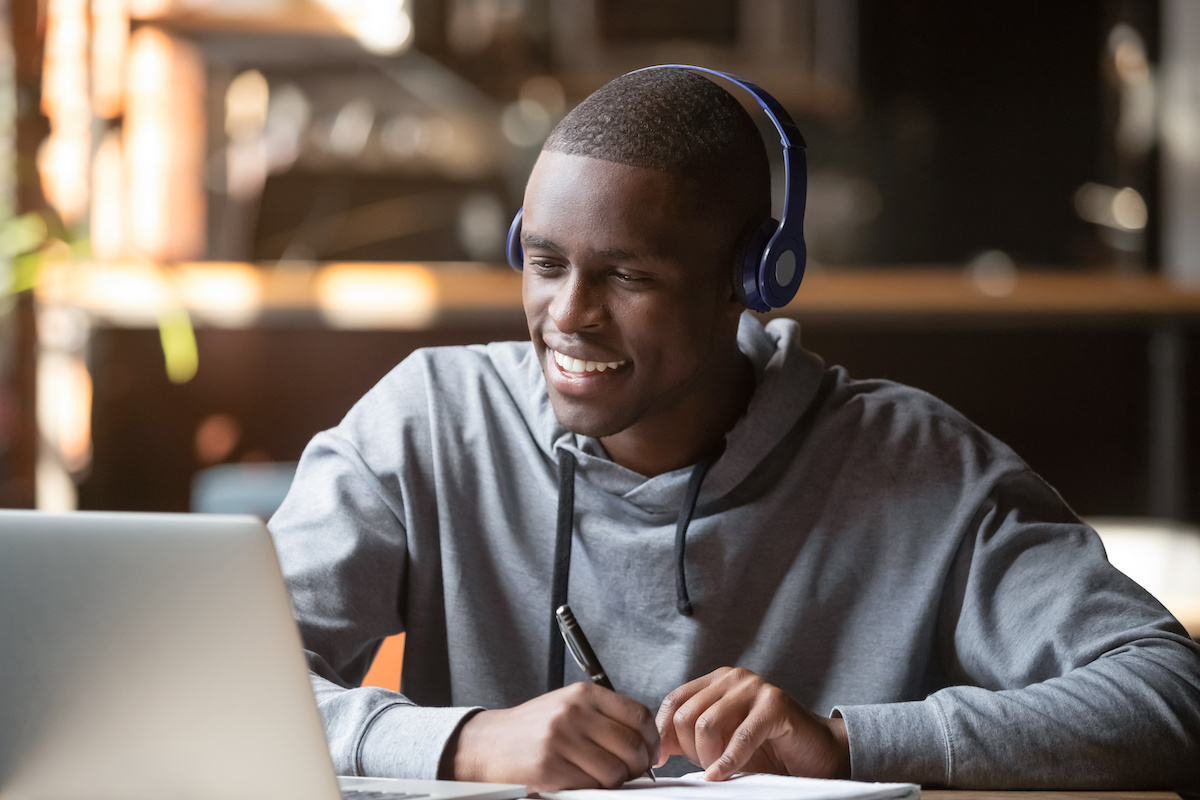 Does music help you study: A student studies while listening to his headphones