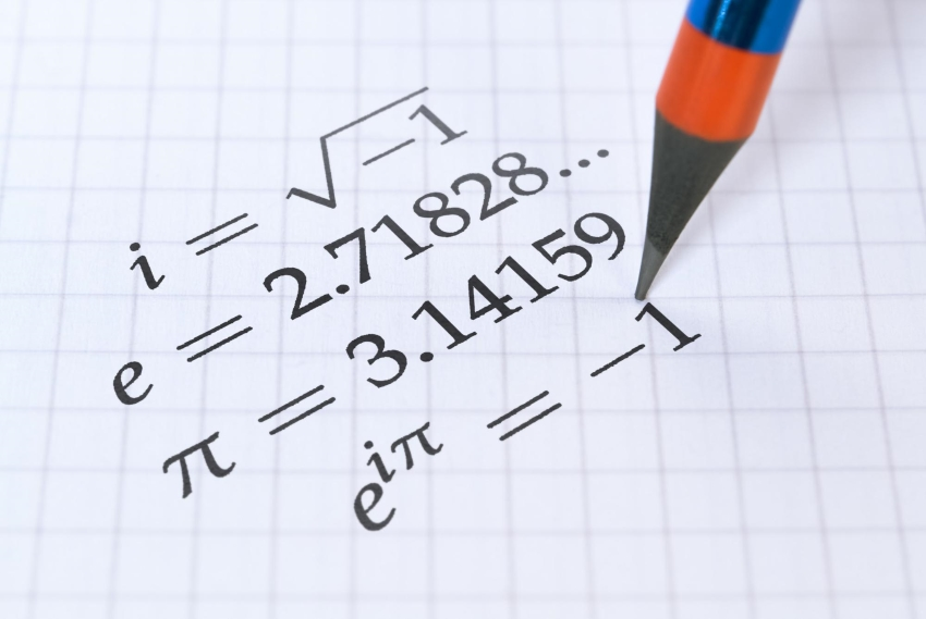 irrational number definition: Mathematical equation on graph paper and a pencil pointing to it