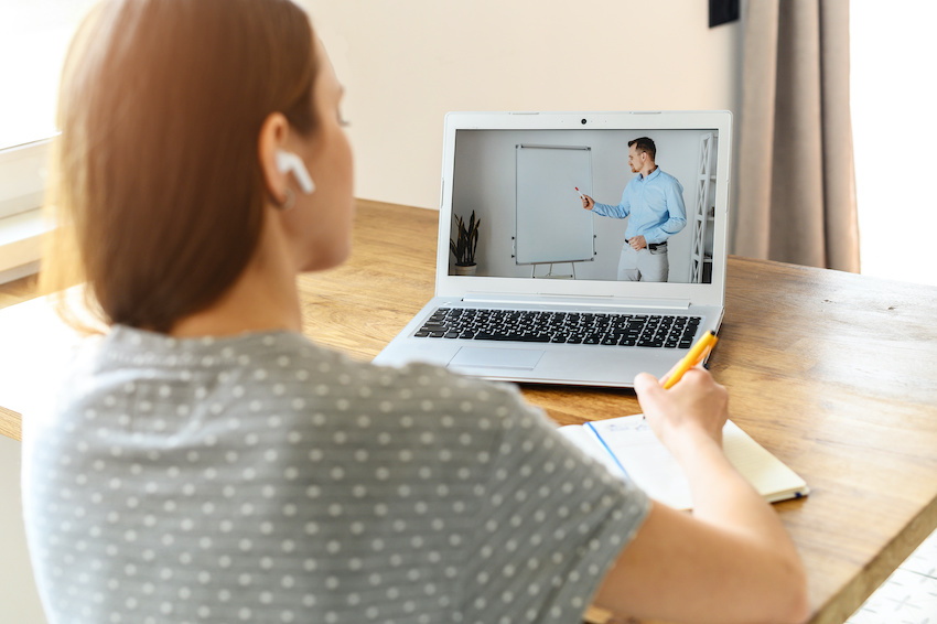 A student uses her computer for a lesson with an online tutor.