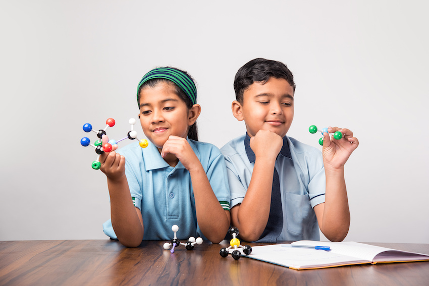 Two students use models to study between sessions with a physics tutor