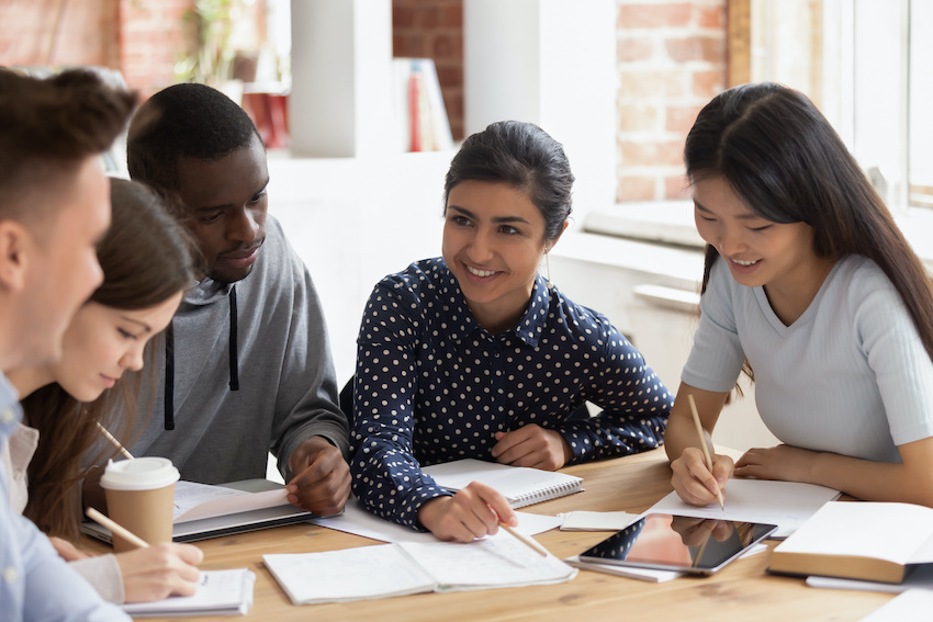 Perfect SAT score: Students and a tutor in a study session