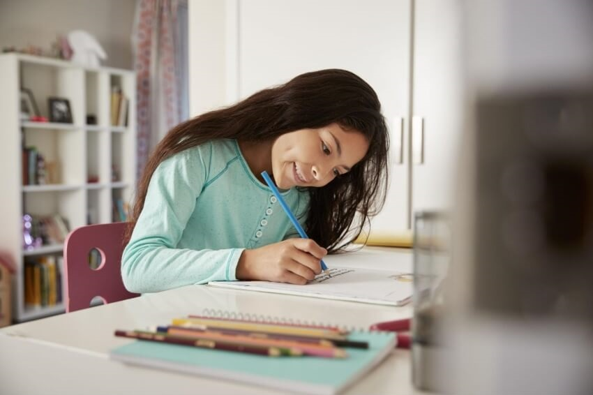 how to find cube root: Smiling girl doing her homework