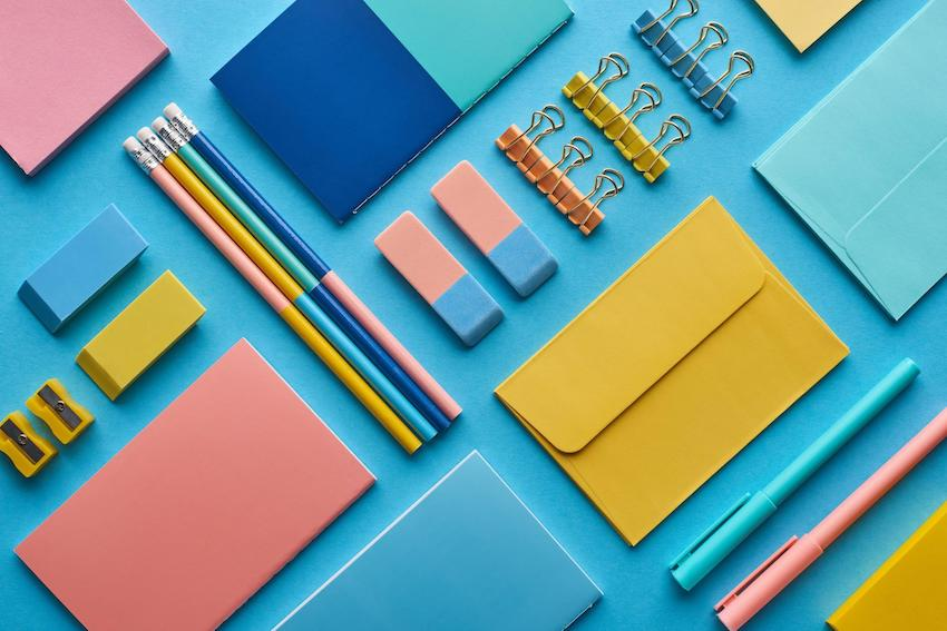 need a tutor: flat layout of pencils, erasers, pens and envelopes