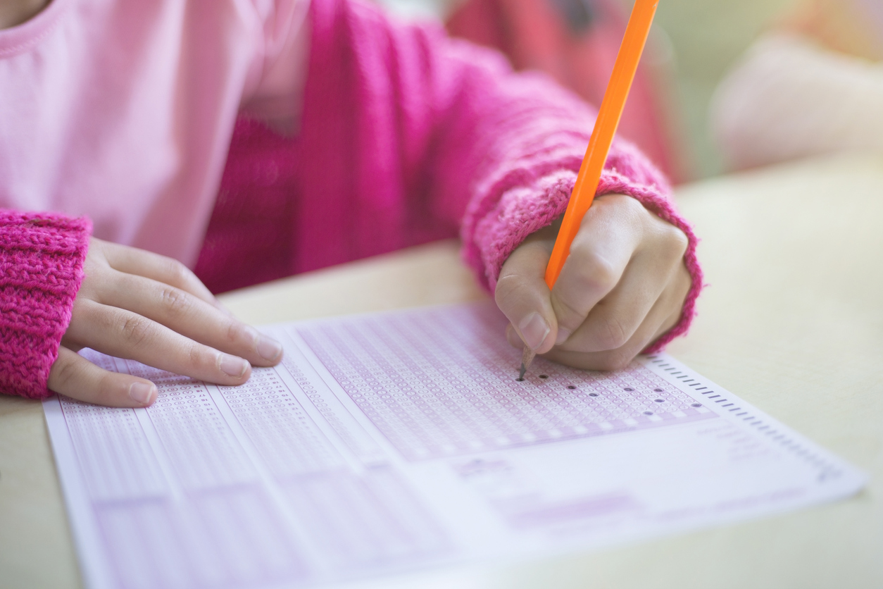 student filling in scantron using test-taking strategies