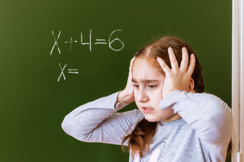 expressions and equations: girl solving a math problem