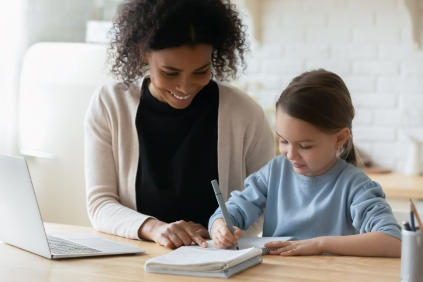 Home school tutoring: Woman tutoring a young girl