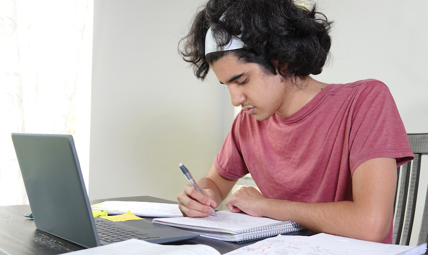 What is an algebraic expression: teenager taking down notes during an online class