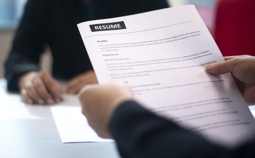 A parent looks at a high school tutor's resume