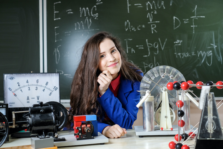 A student in a physics classroom waiting on a physics tutor