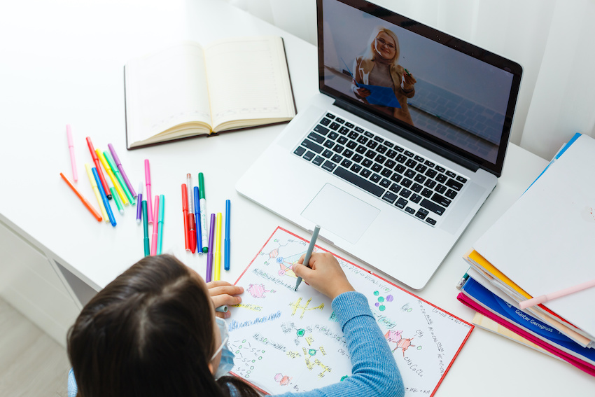 In-person vs. online tutor: An elementary-aged student works with an online tutor