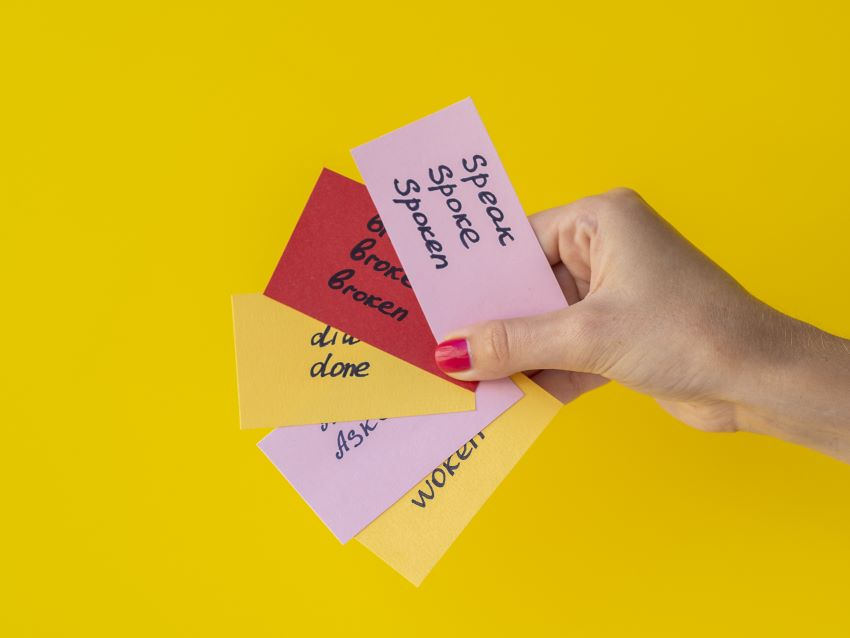 How to make flashcards: a student holds their handwritten flashcards