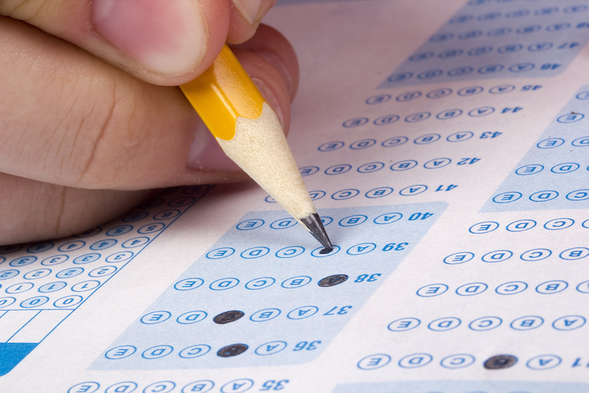 Perfect SAT score: A hand fills out a Scantron sheet with a pencil